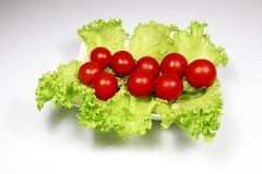 Fresh tomatoes and lettuce. For health Royalty Free Stock Photo