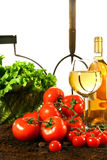 Fresh tomatoes, lettuce and wine Stock Photos