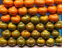 Fresh tomatoes, market stall, food background Stock Image