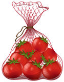 Fresh tomatoes in net bag Royalty Free Stock Image