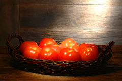 Fresh Tomatoes in Old Wicker Basket in an Old Barn Stock Photos