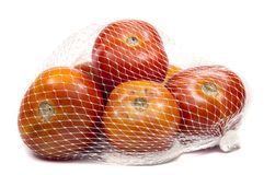 Fresh tomatoes packed. In mesh bag Royalty Free Stock Images
