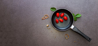 Fresh tomatoes on the pan background. Royalty Free Stock Images