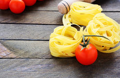 Fresh tomatoes and pasta rolling pin Stock Photography