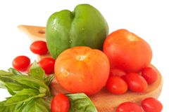 Fresh tomatoes, pepper and basil Royalty Free Stock Image