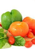 Fresh tomatoes, pepper and basil Stock Photography