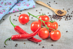 Fresh tomatoes with pepper Stock Photos