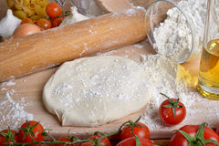 Fresh tomatoes and pizza dough. With olive oil Stock Photography