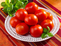 Fresh tomatoes on a plate royalty free stock image