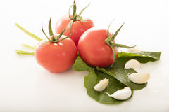 Fresh tomatoes presented on white background Stock Photo