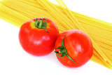 Fresh tomatoes and raw pasta Royalty Free Stock Photography