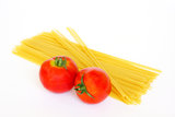 Fresh tomatoes and raw pasta Stock Images