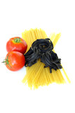 Fresh tomatoes and raw pasta Royalty Free Stock Photo