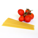 Fresh tomatoes and raw pasta Stock Photography