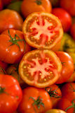 Fresh tomatoes. Fresh red tomatoes cut in halves Stock Photo