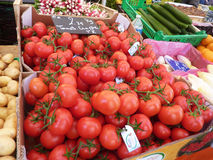 Fresh tomatoes for sale. Tomatoes for sale at an open air farmerr market in France royalty free stock photos