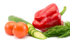 Fresh tomatoes and sliced cucumber and red pepper with green dill isolated on white background. Fresh tomatoes sliced cucumber and red pepper with green dill Royalty Free Stock Photography
