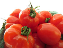 Fresh tomatoes. Small container of bright red strawberry tomatoes Stock Photos