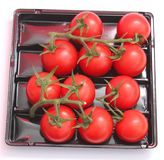Fresh tomatoes. Some fresh tomatoes in a box Stock Photo