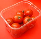 Fresh Tomatoes. Some fresh tomatoes in a box Stock Photos