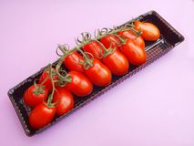 Fresh tomatoes. Some fresh little red tomatoes Stock Images