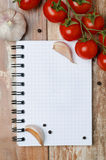 Fresh tomatoes and spices on a wooden background paper for notes Stock Photo