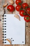 Fresh tomatoes and spices on a wooden background paper for notes Royalty Free Stock Photo