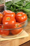 Fresh tomatoes and spinach bowls Stock Photo