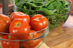 Fresh tomatoes and spinach bowls Stock Images