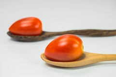 Fresh tomatoes in the spoons Royalty Free Stock Image