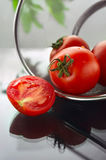 Fresh tomatoes. In strainer on the table Stock Images