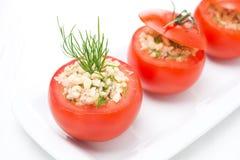 Fresh tomatoes stuffed with tuna salad and bulgur on the plate Royalty Free Stock Image