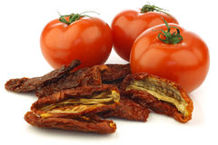 Fresh tomatoes and sun dried tomato pieces Royalty Free Stock Images
