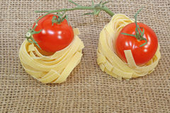Fresh tomatoes  in tagliatelle pasta. Royalty Free Stock Photos