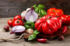 Fresh tomatoes and vegetables Stock Photo