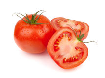 Fresh tomatoes with water drops Royalty Free Stock Photos