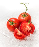 Fresh tomatoes in the water. On white background Royalty Free Stock Images