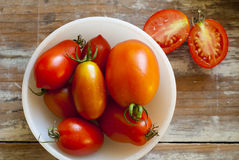 Fresh Tomatoes in White Bowl. Fresh Roma and Juliet tomatoes, picked fresh from the garden, grouped in a white bowl Stock Photo