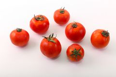 Fresh tomatoes on white. Healthy food, vegetarian Stock Photography