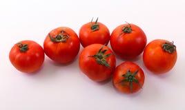 Fresh tomatoes on white. Healthy food, vegetarian Stock Image
