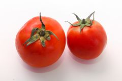 Fresh tomatoes on white. Healthy food, vegetarian Royalty Free Stock Images