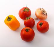Fresh tomatoes, yellow pepper and onion. Fresh tomatoes on white , healthy food, vegetarian Royalty Free Stock Image