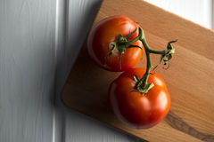 Fresh tomatoes on table Royalty Free Stock Image