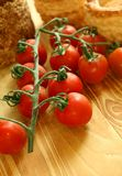 Fresh tomatoes on wooden Royalty Free Stock Images