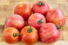 Fresh tomatoes. On wooden background Royalty Free Stock Photo