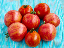 Fresh tomatoes. On wooden background Royalty Free Stock Photography