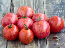 Fresh tomatoes. On wooden background Stock Photos