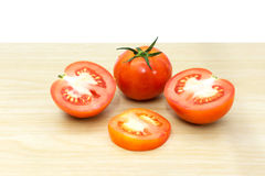 Fresh tomatoes on wooden background. The fresh tomatoes on wooden background Royalty Free Stock Photos