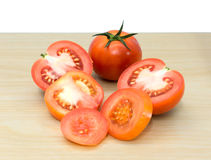 Fresh tomatoes on wooden background. The fresh tomatoes on wooden background Royalty Free Stock Images