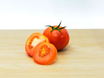 Fresh tomatoes on wooden background. Closeup fresh tomatoes on wooden background Royalty Free Stock Image